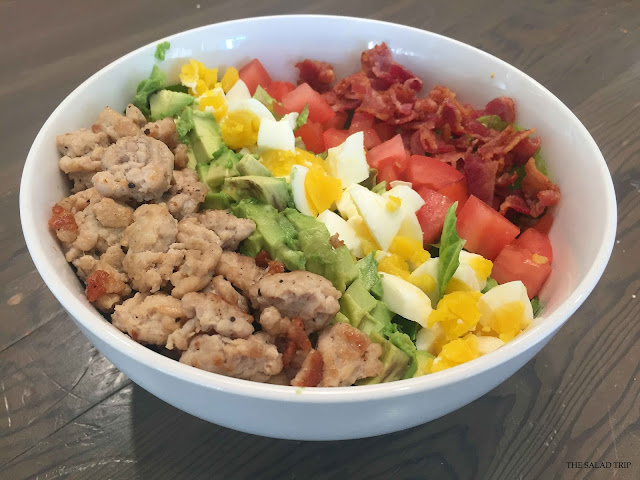 amazing cobb salad that's dairy free, healthy and natural. Chicken, avocado, eggs, tomatoes, bacon and romaine lettuce.