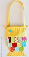http://translate.googleusercontent.com/translate_c?depth=1&hl=es&rurl=translate.google.es&sl=en&tl=es&u=http://www.makeit-loveit.com/2011/12/fabric-fishy-purse-pattern-pieces-included.html&usg=ALkJrhhnZIHcJ039g2d0aAqDW0RAh-fq9g