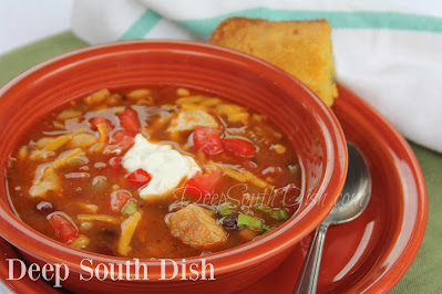 A blend of Tex-Mex seasonings, pantry staples and some cooked chicken make for a quick and hearty chicken soup. Shown here with my Honey Jalapeno cornbread.