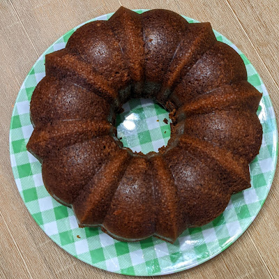 overhead shot of bundt cake on a green and white checkerboard plate