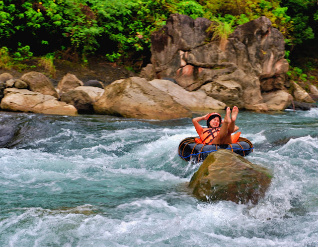 Karla Ramos having fun while river tubing in Tibiao, Antique