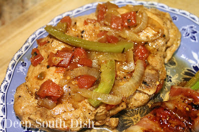 Seasoned and seared pork chops, simmered with tomatoes, onion and sweet bell peppers.