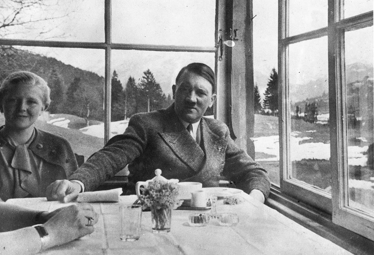 An oddly intimate photo of Hitler with Eva It was taken in ski resort Garmisch Partenkirchen (later home to a major US military base). This is a rare shot of Hitler relaxing, thus this is an astonishing picture, especially given the possessive placement of Hitler's right hand.