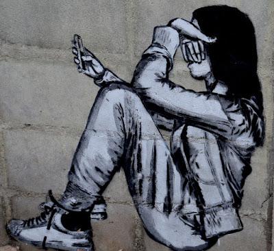 Depressing photo of girl on her smart phone.