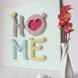 scritta home in string art