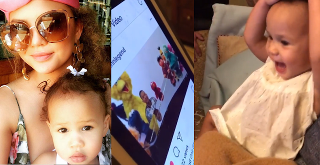 John Legend and Chrissy Teigen's daughter Luna enjoying the video of her dad along with Sesame Street Characters in the show