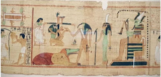 Scene from the Books of the Dead (The Egyptian Museum) showing the ibis-headed God Thoth recording the result of the final judgment
