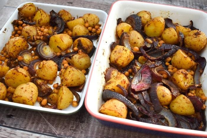 potato bake in two white baking dishes