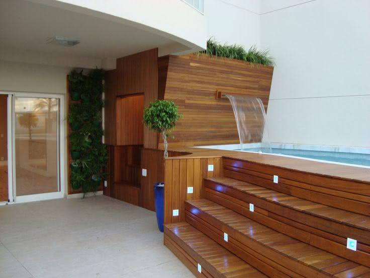 Wooden pool waterfall