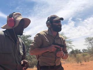 Jack Carr holding a gun.