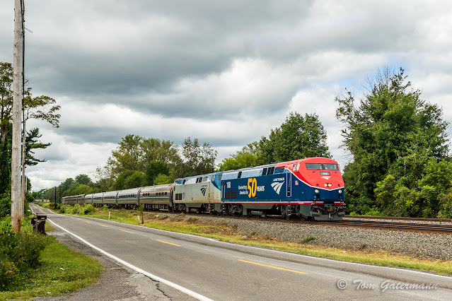 AMTK 108 and AMTK 101 lead the Lake Shore Limited along Saintsville Rd. at Kirkville, NY