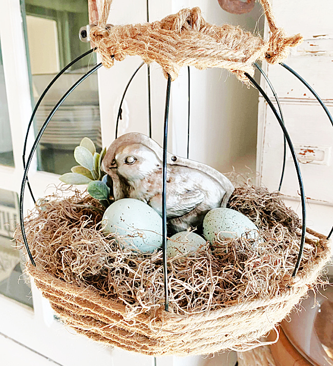 jute basket with eggs and silver chick