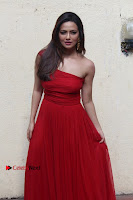 Actress Sana Khan Latest Pos in Georgius Spicy Red Long Dress at the Interview  0005.jpg