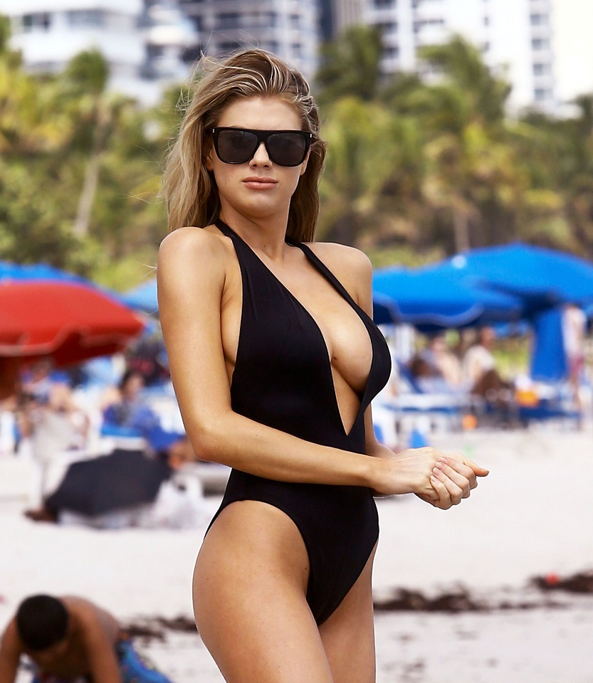 Charlotte McKinney exposes her chest while wearing a very risque swimsuit on the beach in Miami