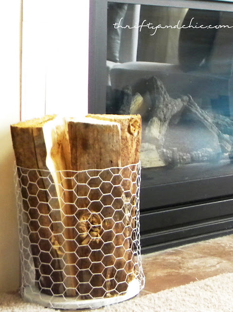 http://www.thriftyandchic.com/2011/09/chicken-wire-firewood-holder.html