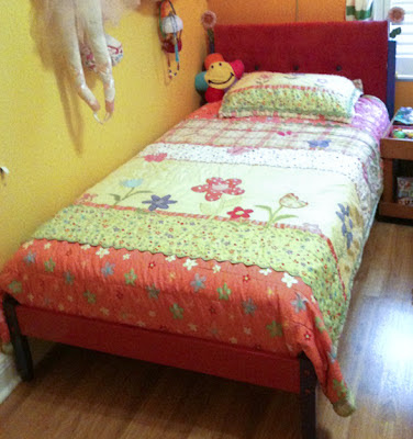 DIY bed in red corduroy with tufting