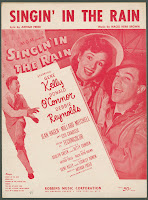 A cover page for sheet music to Singing' in the Rain, featuring photographs of the film's stars in red.