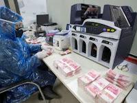 Uang Tunai Mampu Tularkan Virus Corona? Ini Penjelasan Dokter