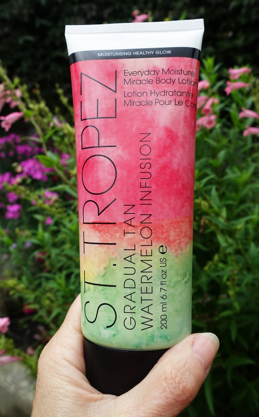 The pink and green bottle of St Tropez Gradual Tan Watermelon Infusion