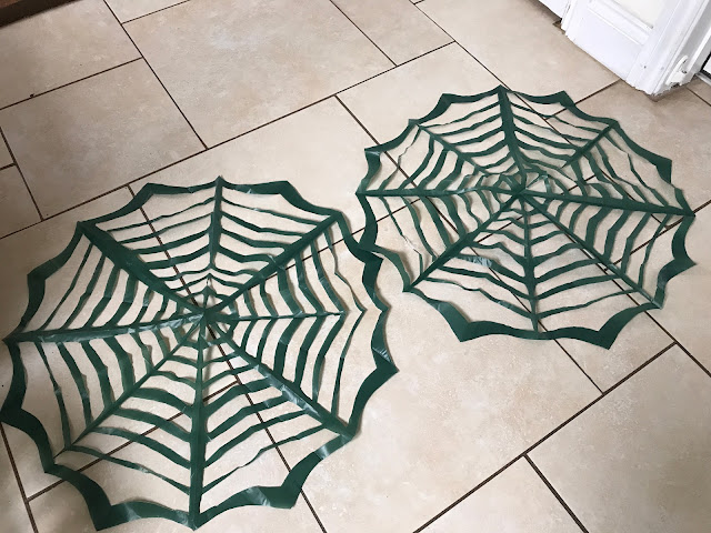 black sack spider webs DIY Halloween Crafts