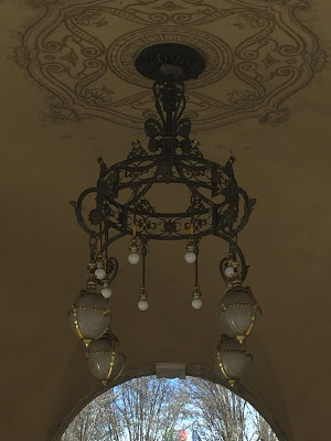 Light fixture under the portici near Balzer Pasticceria