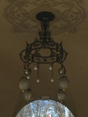 Light fixture under the portici near Balzer Pasticceria