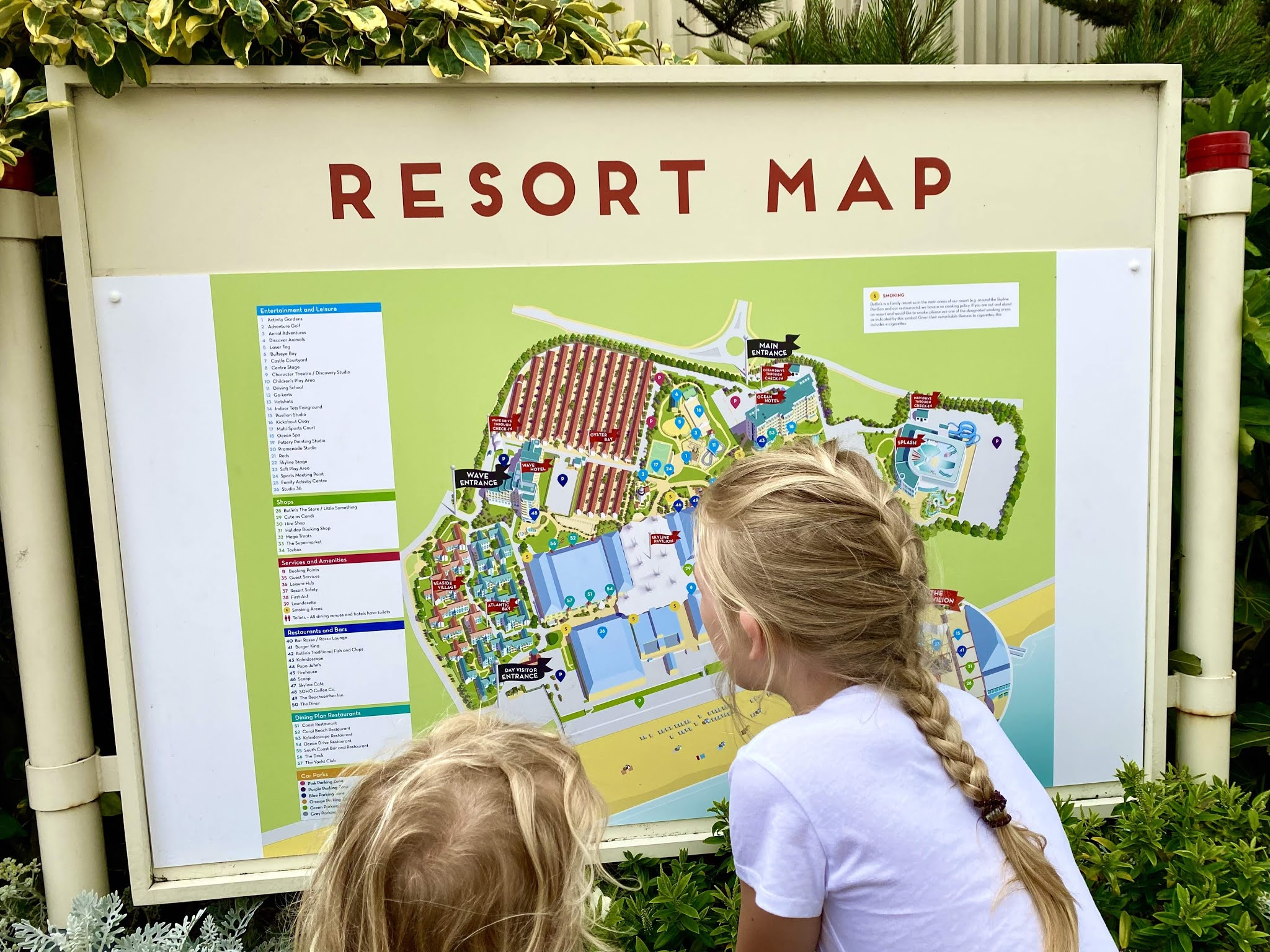 two children looking at the Butlins Bognor Regis Resort Map showing where all the different accomodation is