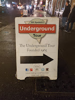 "Sign with right arrow stating ""Bill Speidel's Underground Tour: The Underground Tour Founded 1965"""