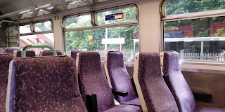 Seats on Northern's ex-First Scotrail 156 still with the old First moquette.