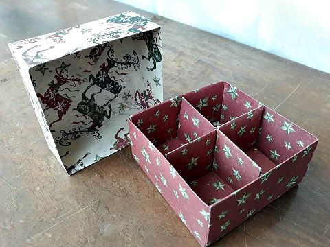 square folded paper box top and bottom with paper dividers creating four sections