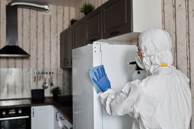 https://www.pexels.com/photo/person-in-a-protective-suit-disinfecting-inside-the-house-4099260/