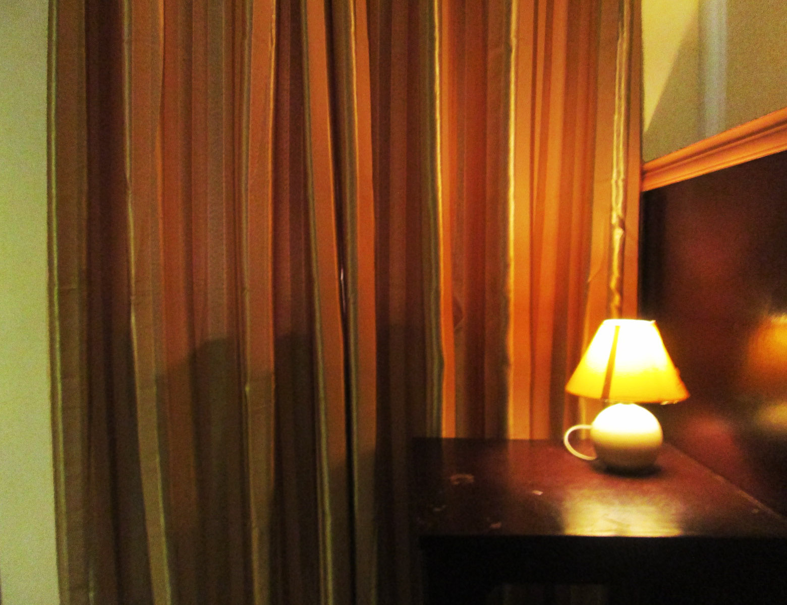 Gold curtains and brown-furnished furniture is complementary.  Twin Hearts Resort.