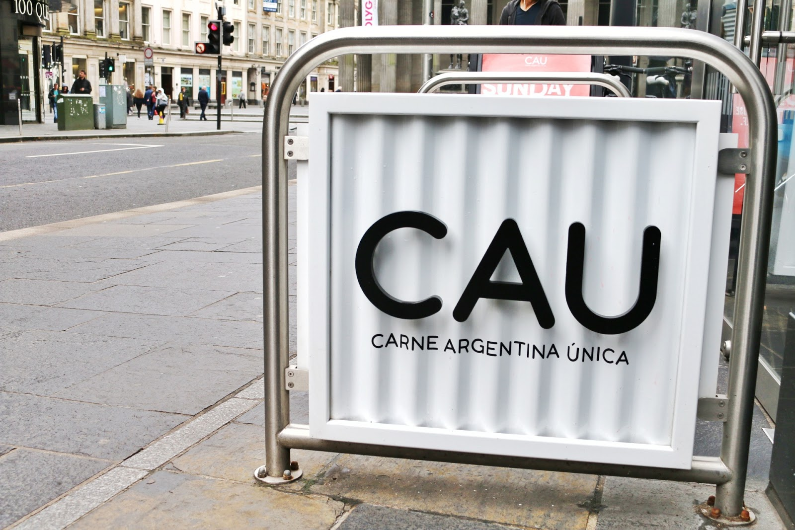 Close up of the CAU Glasgow sign which is a white board with black writing