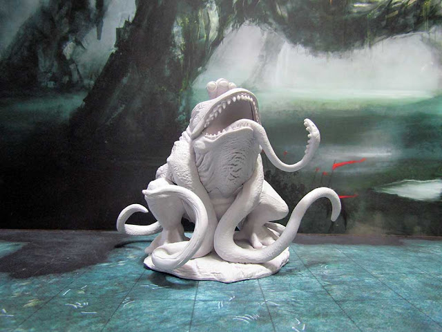 Wizkids's Unpainted Miniatures: Hill Giant and Froghemoth