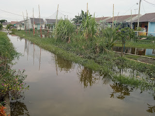 Banjir Rendam Kompleks Perumnas Griya 3 Martubung