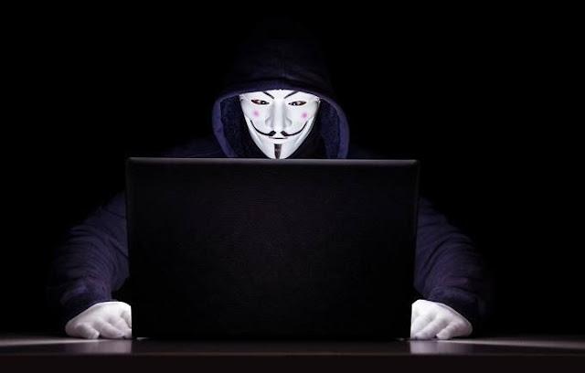 hacker-laptop-anonymous-logo