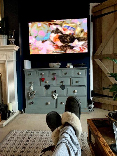 feet of someone watching tv