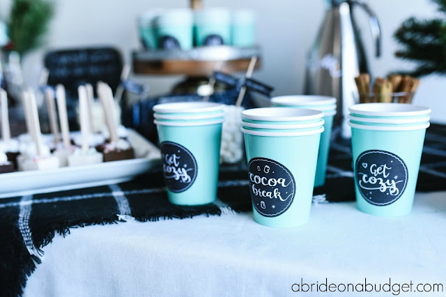 A DIY Hot Chocolate Bar would be PERFECT for your winter wedding. Find out how to make one at www.abrideonabudget.com.