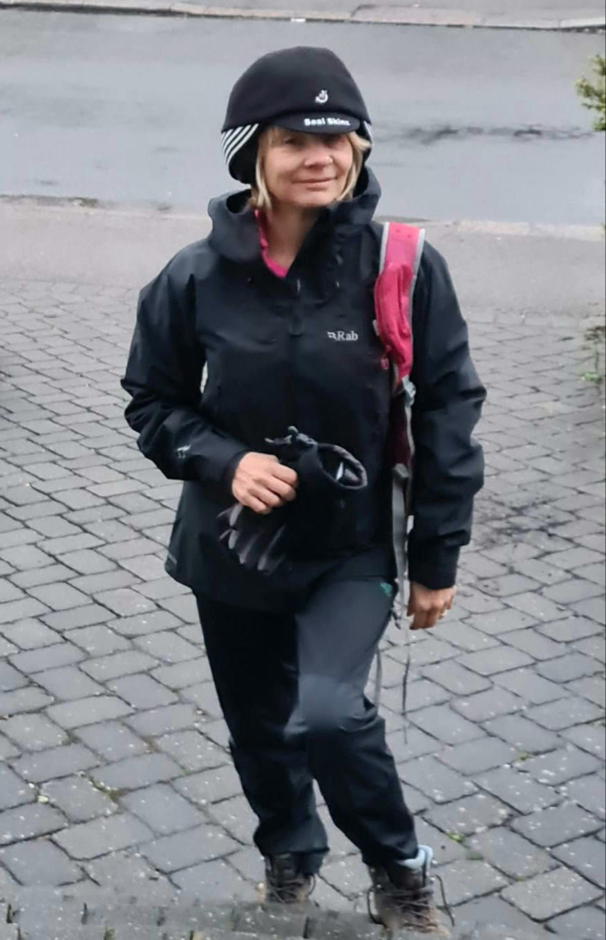 Wet weather walking outfit worn by Gail Hanlon of Is This Mutton featuring Rab waterproof trousers and jacket and Seal Skinz hat which protects headphones