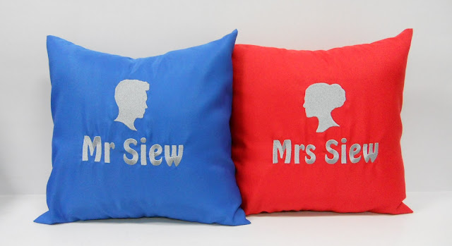 Blue and red cushions with personalized name embroidery