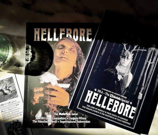 Photo of issues 1 & 2 of Hellebore sitting side by side cover up to show the artwork