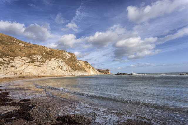 Man O War Bay under fluffy clouds on the Dorset Jurassic Coast