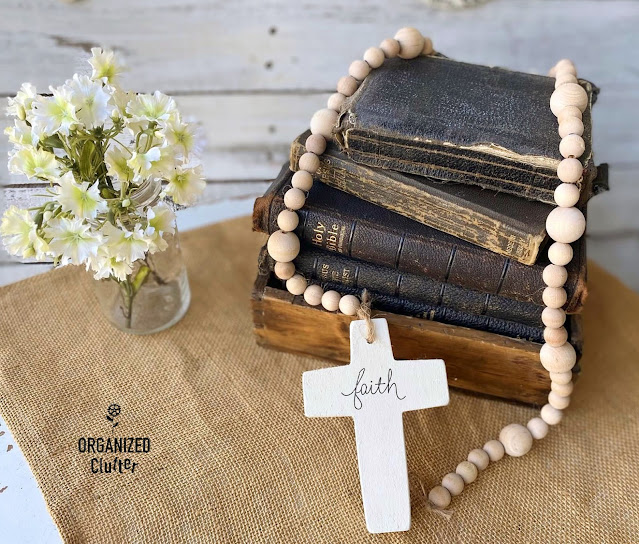 Photo of Bibles and wooden beaded garland with Cross