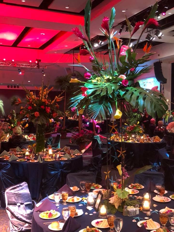 Shirleys flowers the board of directors head table was designed by monroe cranford of flowers and home bryant and hot springs ar the lava columns palm trees and tiki mightylinksfo