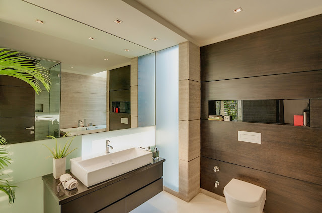 Picture of huge mirror and modern furniture in the bathroom