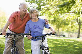 Man with his wife on a bike ride