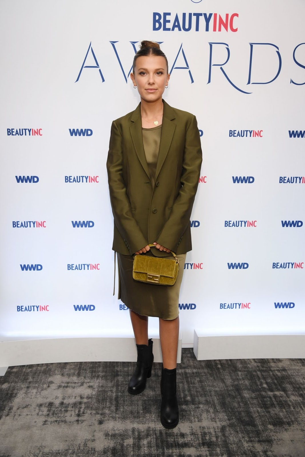 Millie Bobby Brown goes demure in olive green ensemble at the WWD Beauty Awards