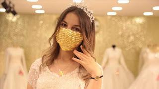 في تركيا.. كمامات مطرزة بالذهب للعرائس (صور)