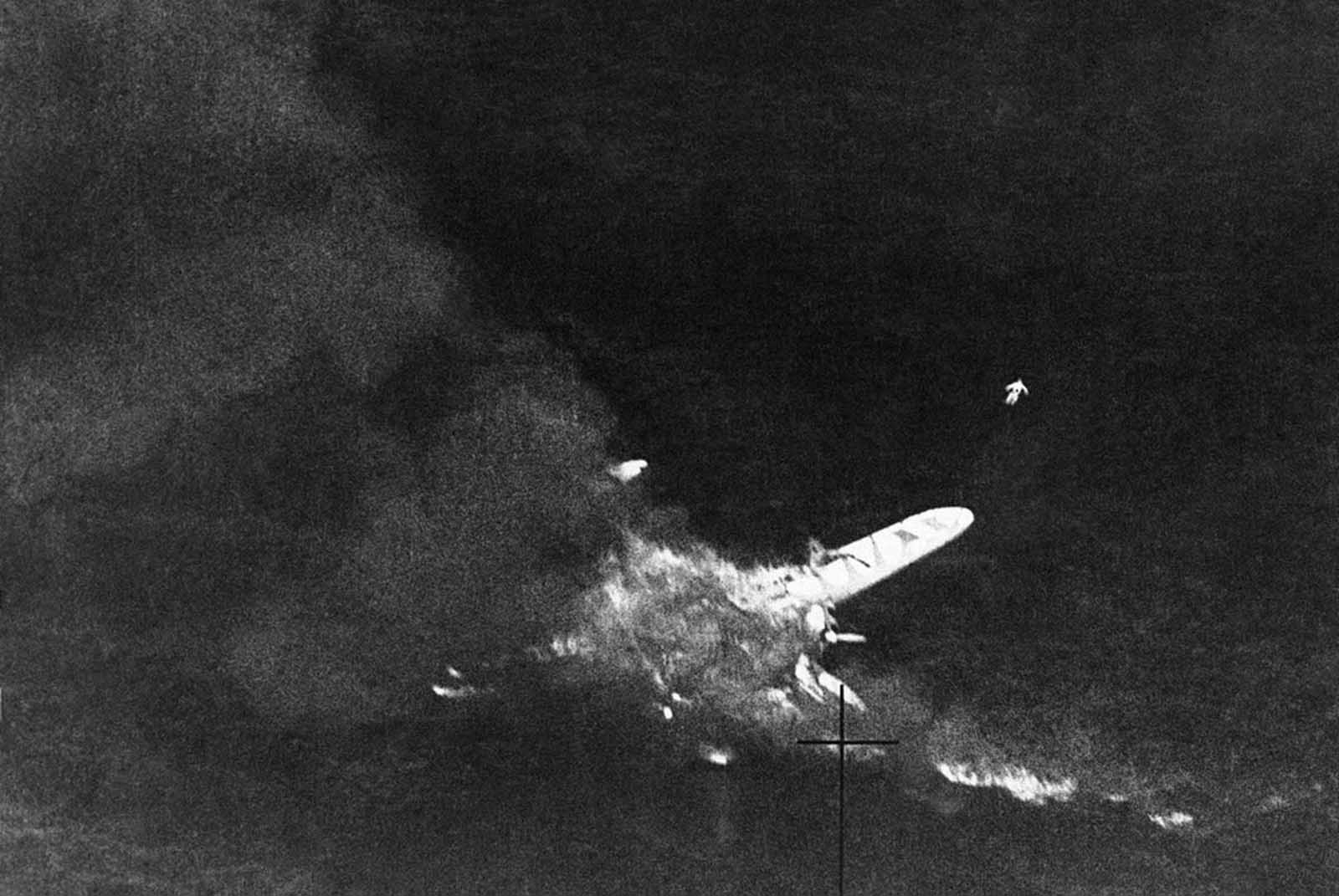 An Italian flying boat burning of the water off the coast of Tripoli, on August 18, 1941 after an encounter with a royal air force fighter patrol. Just above the tip of the port wing, the body of an Italian airman can be seen floating.