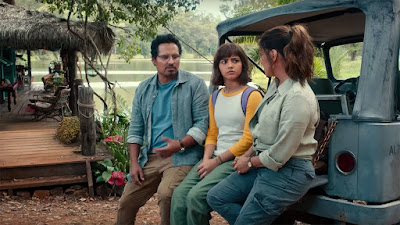 Movie still for the 2019 film Dora and the Lost City of Gold where Isabela Moner talks to Eva Longoria and Michael Peña about going to high school